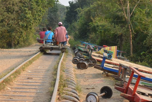 riding the bamboo train on old train tracks from the French colonial days. Parts of train 'cars' are beside the track.