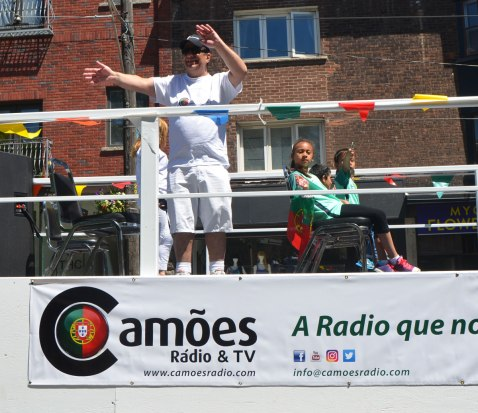 A float in a parade featuring the Portuguese Radio and TV stations, Camoes,