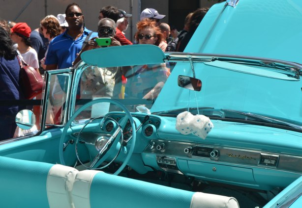 an old convertible car, Chevrolet Belair, with top down, turquoise car with matching white and turquoise interior