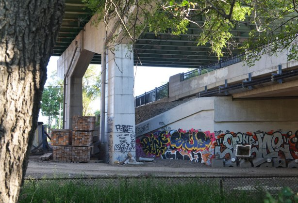 The elevated Gardiner Expressway passes over Strachan Ave which in turn has a bridge over what used to be a rail line. The bottom part of the bridge is covered with graffiti. The whole area is a construction site at the moment.
