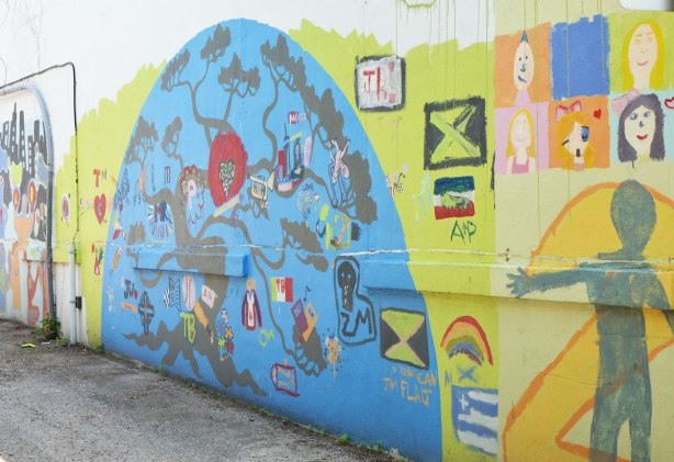 Part of a mural in an alley painted by students from Gledhill Public school, graduating class of 2010. A blue semi-circle