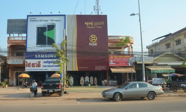 large signs on the outsideo f two adjacent stores in Kampong Cham. One is for Samsung products and the other is for Prime ceramic tiles