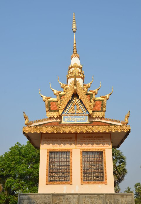 top part of a stupa, pagoda shaped, glass window in the side where you cansee the bones of dead people