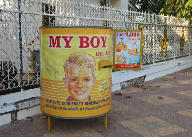 An ad for My Boy sweetened condensed milk. It is a large replica of the can, a white boy's face is on it.