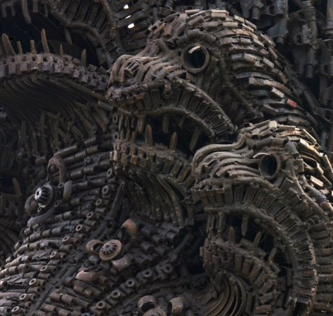 close up of Naga sculpture made with parts of destroyed weapons. - three of the heads.