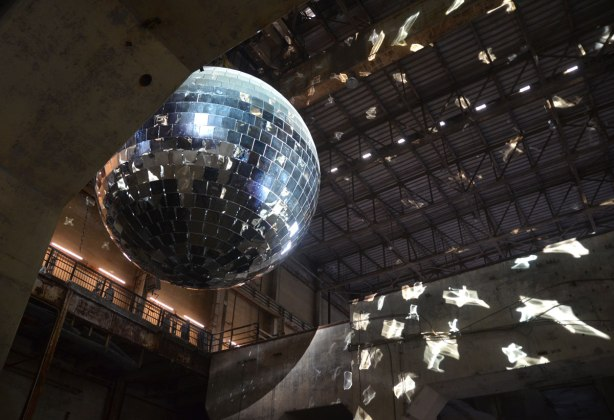 One thousand specualtions, a mirror ball with 1000 mirrors, inside the hearn generating station as part of luminato festival