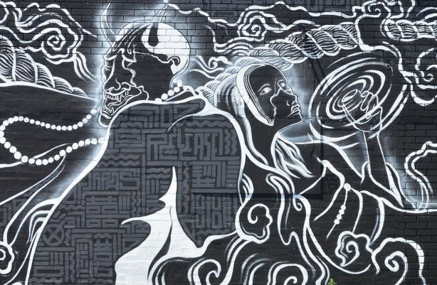 detail of a white drawing on black mural, ceter portion, devil and angel, by Oscar Kwong, release852