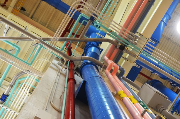 A myriad of pipes running up walls and across the ceiling, blue, pink, red, grey, all colour coded, interior, Leslie Barns