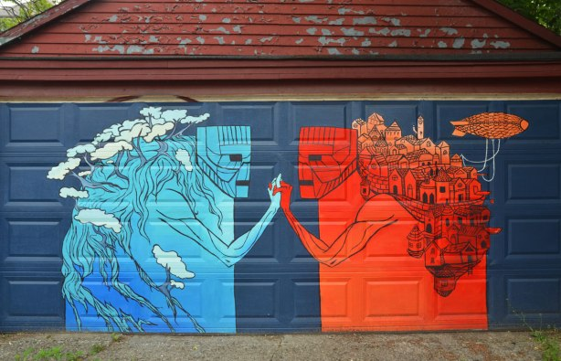 a mural on a garage door, a blue figure on the left and an orange figure on the right. Blue represents nature and red represents the urban city