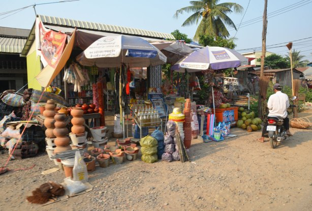 a roadside store selling clay pots