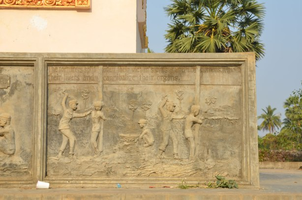scene depicting torture by the Khmer Rouge, sculpture on a memorial stupa, Wat Samrong Knong