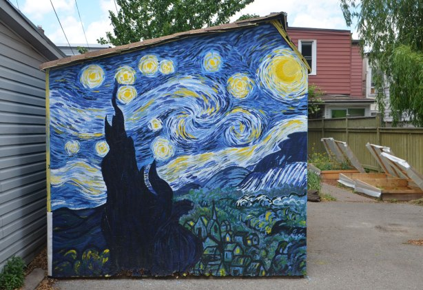 a copy of Vincent Van Gogh's 'Starry starry night' is painted on the side of a shed in a backyard.