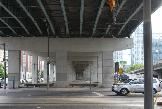 under an elevated section of the Gardiner Expressway, at Spadina.