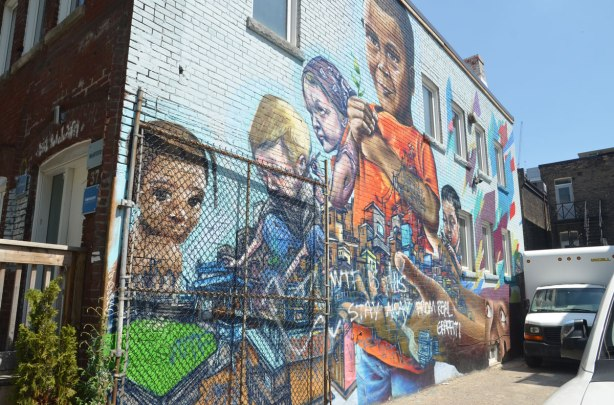 mural on the side of a building, kids playing