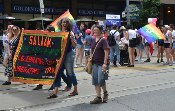 two groups, one Muslim and one Jewish, walking in a Dyke March