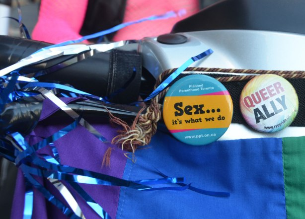 "A button that says ""Sex, it's what we do""."