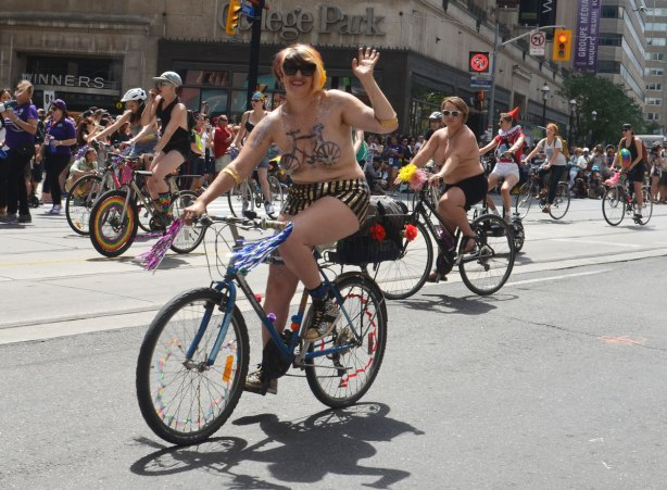 topless bare breasted cyclists in dyke march
