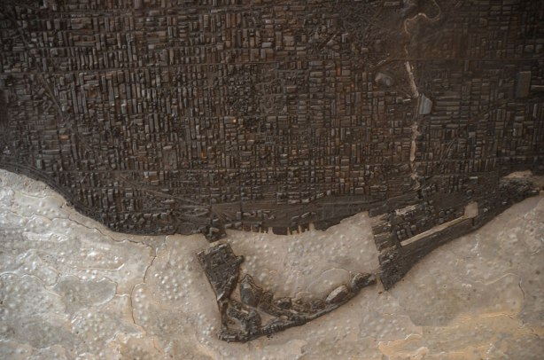 detail of the islands and downtown area of map of toronto made of charred wood and lead, meant to resemble the city after an atomic bomb, large, made by Matthew Day Jackson