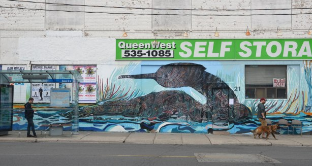 large mural of a water fowl sitting on the water on the old white Queen West self-storage building.