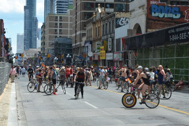 walkers in a dyke march in Toronto - a large group of cyclists on Yonge Street, Dykes on bikes