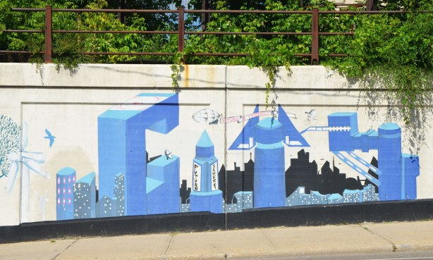 part of a mural, the word city is used to make a futuristic urban scene in blue tones. The future is friendly.