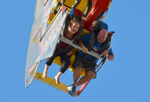 two people upside down on a ride at the CNE,