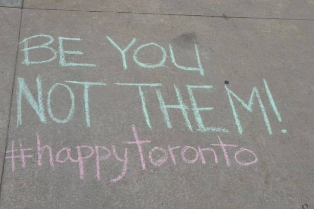 words written in chalk on the sidewalk, Be you, not them! #happytoronto