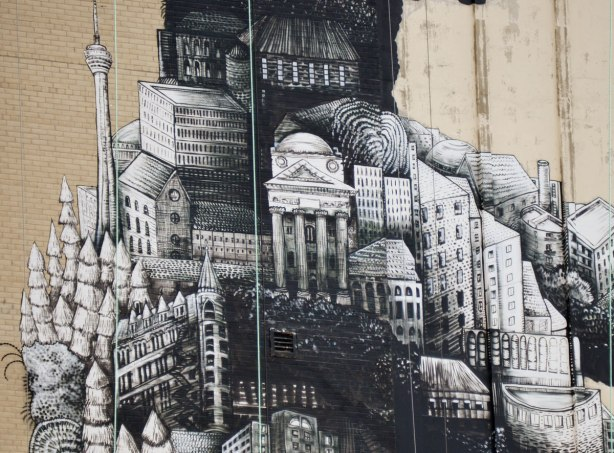 close up of mural made up of toronto landmarks like the cn tower and the gooderham flatiron building