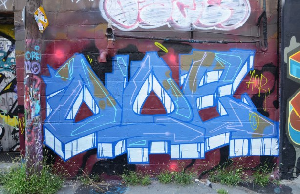 street art text painting in blue