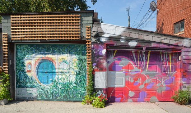 two adjacent garage doors, one with a bright abstract design and the other with a garden scene