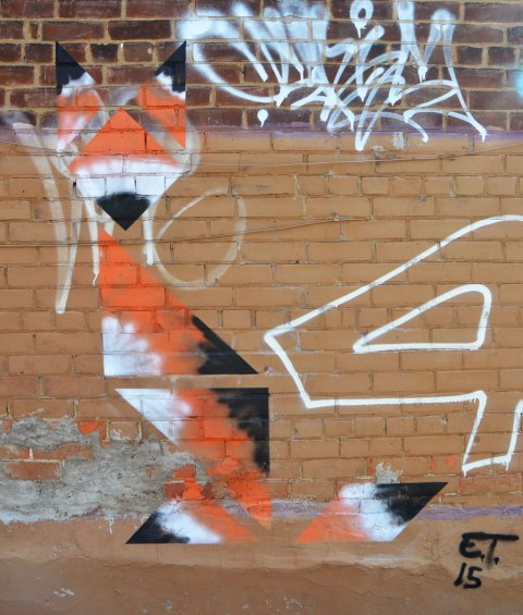 a street art picture of a fox made of triangles in orange black and white