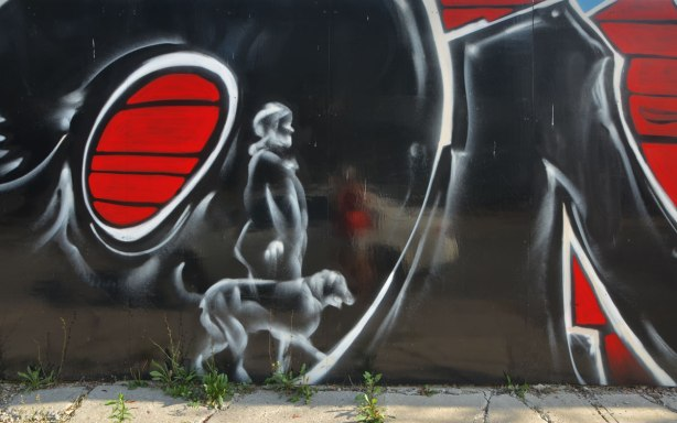 part of a mural, man walking a dog