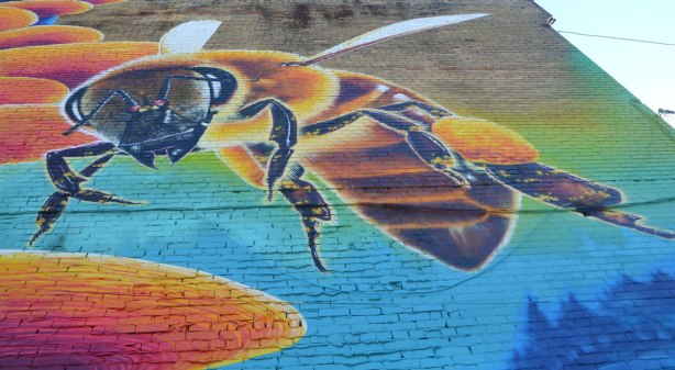 part of a mural, a large bee
