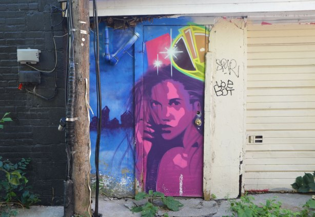 streeet art picture of a woman in pink and purple