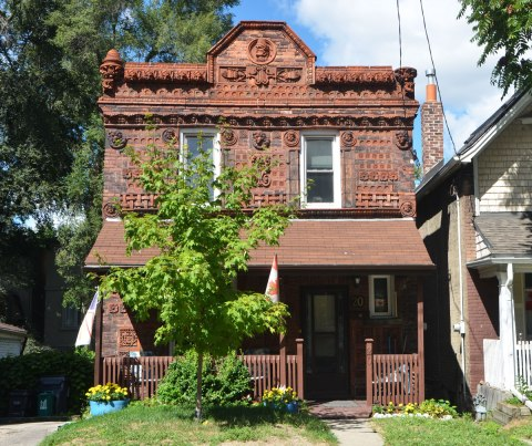 house covered with terra cotta tiles with different designs on them.