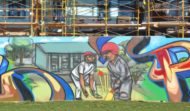mural showing two male cricket players