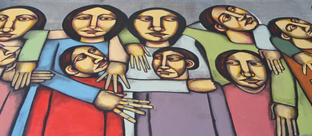 a mural of a group of people linked together with their arms.