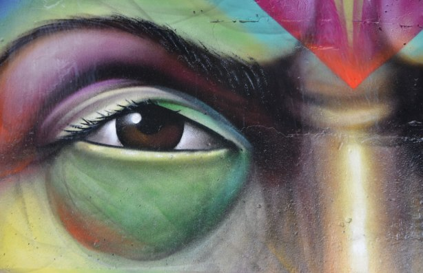 close up of an eye from a face on a mural by Shalak Attack