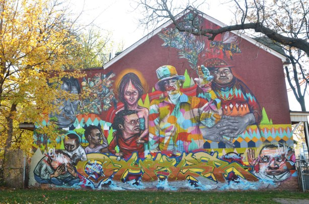 large mural on the side of a house at the edge of Alexandra Park in Toronto, painted by Elicser and Troy Lovegates