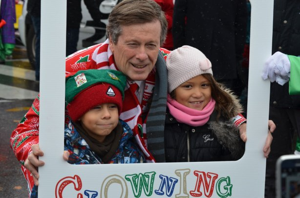 Santa Claus parade - Toronto mayor JOhn Tory poses with two kids at the start of the parade