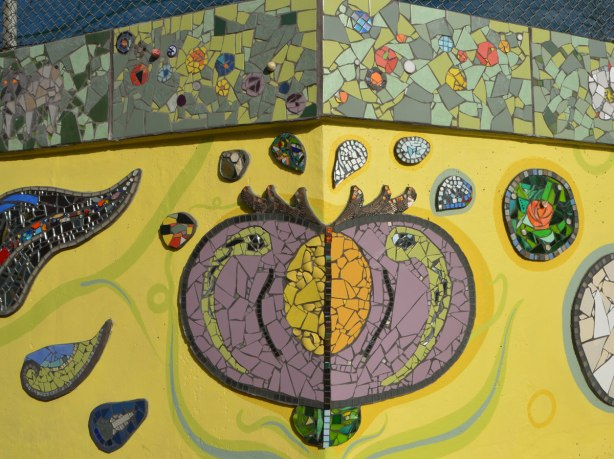 mosaic representation of a large seed pod that hs released its seeds.