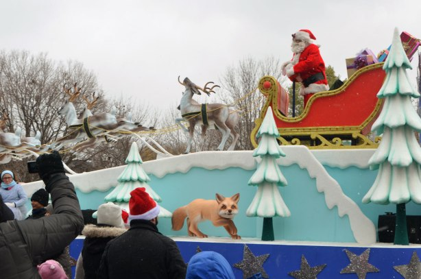 Santa Claus parade - at the end of the parade, Santa arrives on his sled being pulled by reindeer