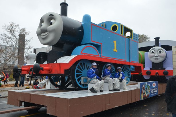Santa Claus parade - a float with a very large replica of Thomas The Tank Engine with three kids sitting beside it.