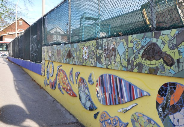 west side of the mural, yellow wall, Coxwell station, mosaic pictures