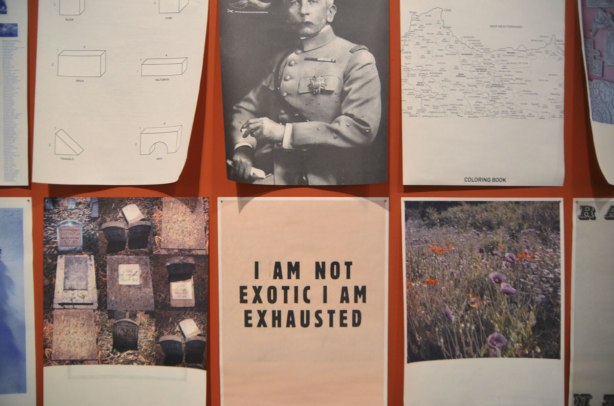 Part of an exhibit by Yto Barrada of a series of posters printed on paper and loosely tacked to the wall, of images and words. 6 shown in this photo. Including one that only has a few word on it, I am not exotic I am exhausted.