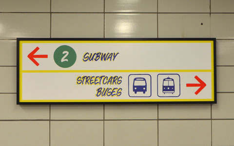 sign maker from Honest Eds store has redone some of the signs in Bathurst subway station plus, he has added some Honest Ed type promo signs around the station - the direction sign to subway and to exits.