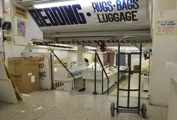 interior of Honest Eds store as it gets ready to close down. The bedding section is being torn apart and dismantled