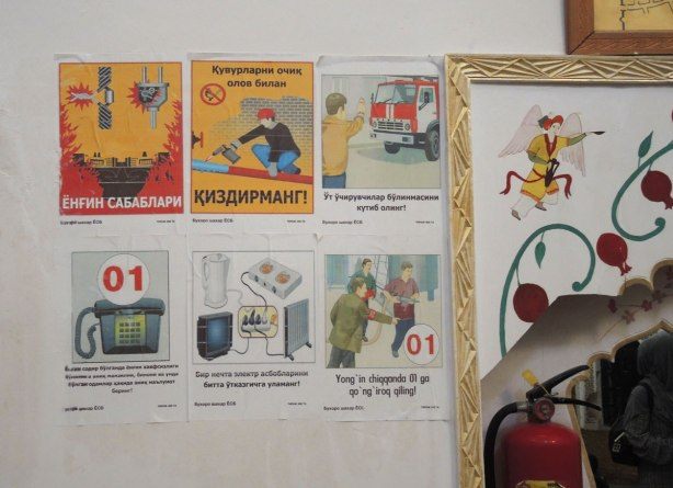 posters on the wall of a hammam showing emergency procedures, in Russian, old,