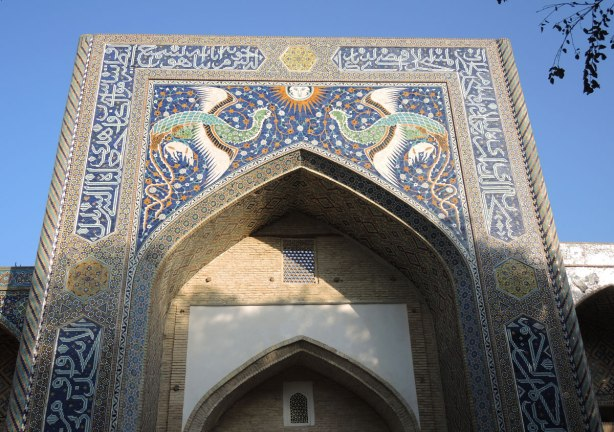 phoenix and sun made of mosaic tiles over the entrance of a madrassah in Bukhara, the Nadir Divan Begi Madrasah