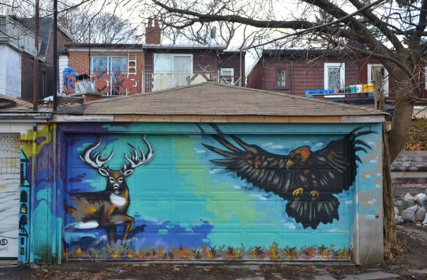 mural on a garage door, a deer and a hawk